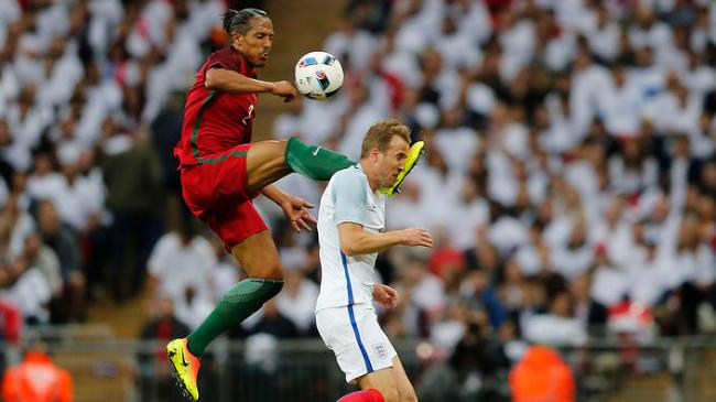Portugal's Bruno Alves, left, fouls England's Harry Kane during the International friendly soccer match between England and Portugal at Wembley stadium in London, England, Thursday, June 2, 2016 . (AP Photo/Frank Augstein)